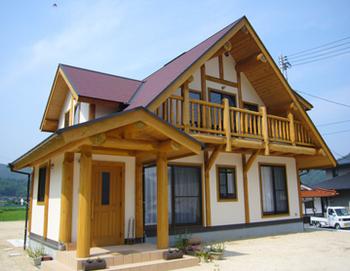 田舎町の立派なログハウス.png